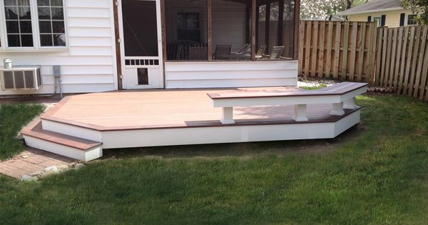 vinyl patio deck using wolfbuilding pvc decking with amberwood flooring and rosewood border. Black Bedroom Furniture Sets. Home Design Ideas