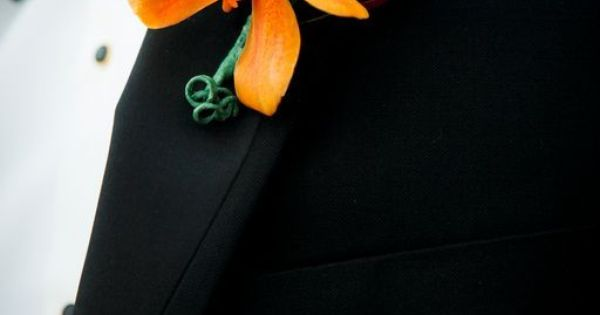 mokara orchid boutonniere | Mokara orchid and leucadendron boutonniere from Jeri Solomon