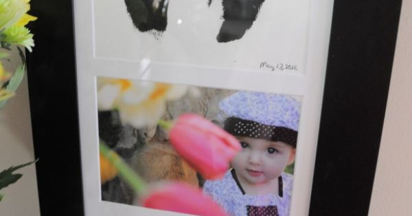 Picture frame with 3 slots. Child's hand prints and foot prints, then
