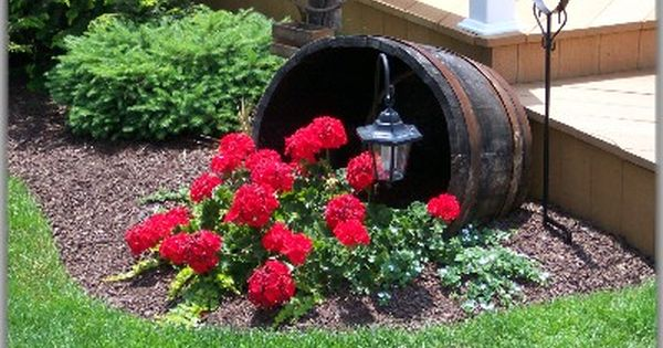 Fill an Old Whiskey barrel with flowers and add a solar light....