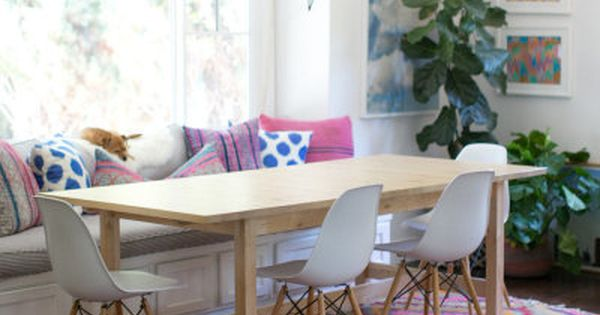 Add A Bold Chandelier And Bright Rug To Your Dining Area