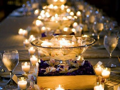 Candles galore! What a simple and romantic table setting, inside or outside.
