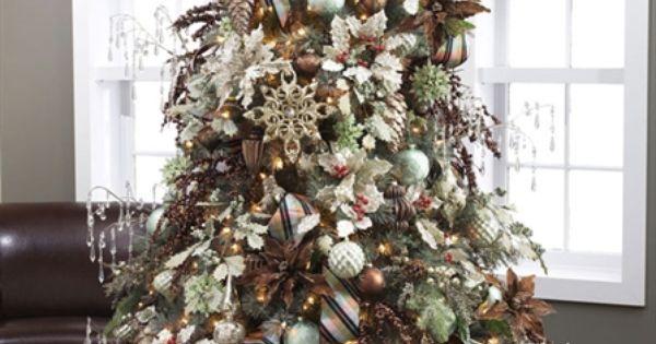 An ornate christmas tree pairing delicate elegance dark