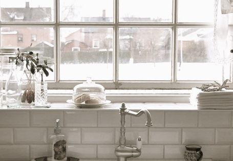 great farm sink, subway tile and industrial window. White on white or