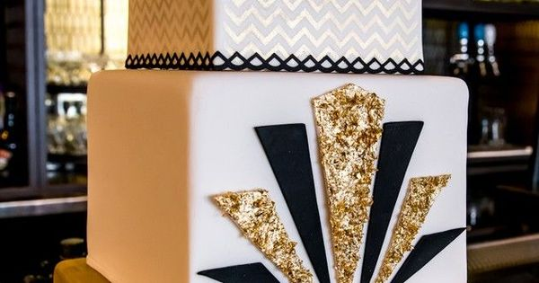 Three-tiered gold and black Art Deco wedding cake