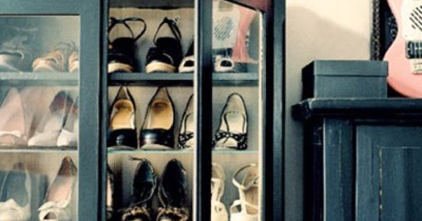 Old cabinet repurposed for shoe storage. Great idea of old china cabinet