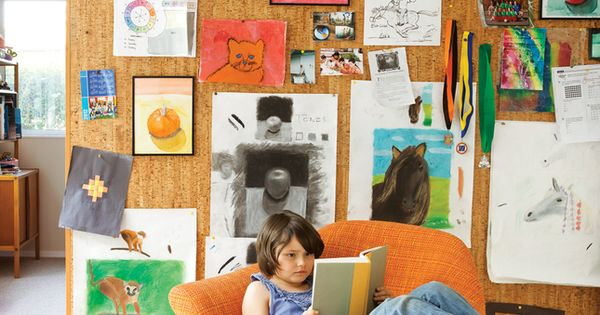 Cork board wall displaying kid's arts / devis purdy house / dwell