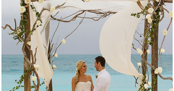 Rustic driftwood style beach wedding arch in The Caribbean. Brilliant Studios, Turks