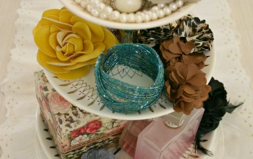 A vintage cupcake stand from Goodwill for accessories! LOVE THIS IDEA!!! I