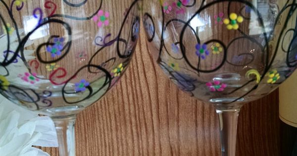 Give hand painted wine glasses to go with all the bottles Wine glasses to go