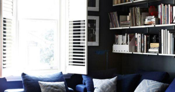 deep blue sofa and dark blue walls...