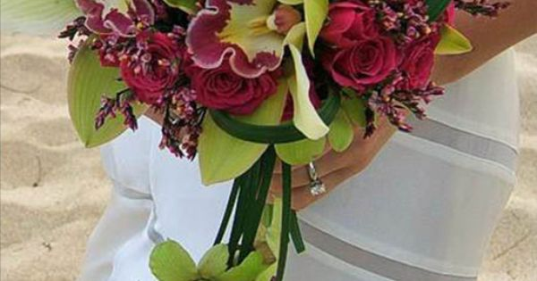 Bouquet of cymbidium  dendrobium orchids, mini spray roses, lily grass and diamond statice.