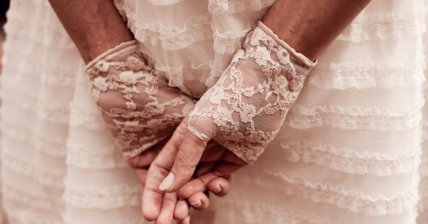 pretty lace gloves accessorize a ruffly white bridesmaid dress Photography by angelsmithphotogr...