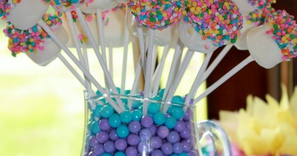 marshmallow pops dipped in white chocolate and sprinkles