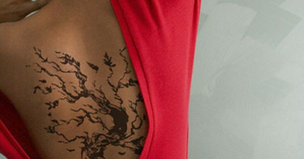 brown tree tattoos on back. also I really love the dress she
