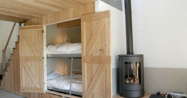 ski bunk beds tucked under stairs Love this space saving idea for