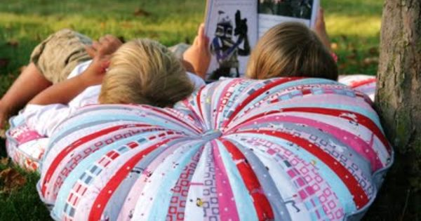 Super Cute DIY fabric scrap Jelly Roll Floor Pillows