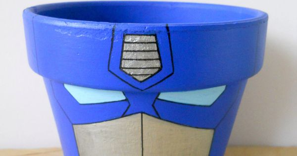 Transformers Optimus Prime painted flower pot. I love painting pots- never even