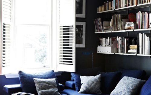 deep blue sofa and dark blue walls...
