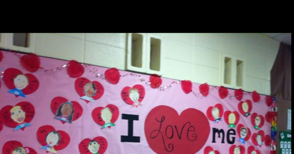 Our Valentine's Day bulletin board. With kids' self portraits and adjectives describing