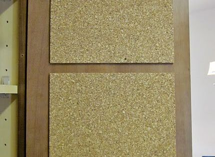 Cork board inside cabinet door. Great idea for recipes or other notes