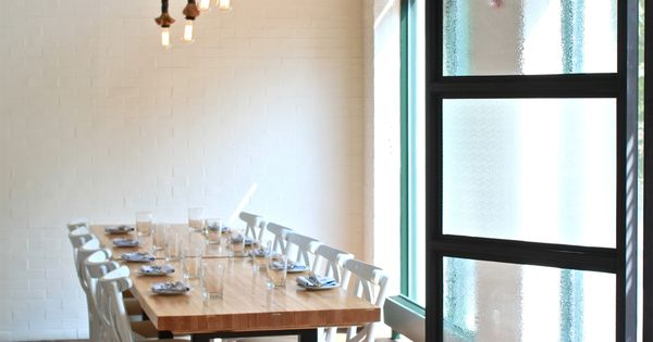 Lighting, use of rope industrial modern restaurant design - love the clean