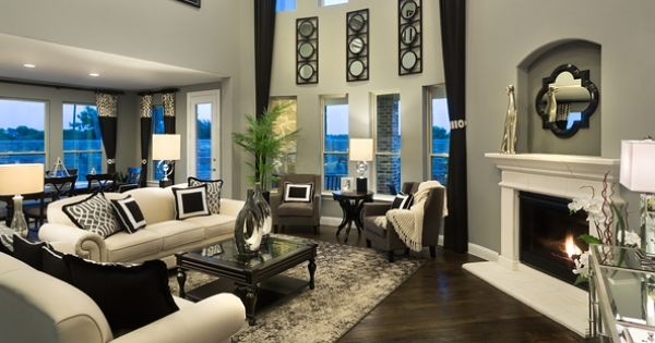 Spacious two story family room black white and grey high for Black and beige living room ideas