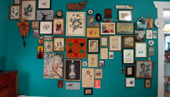 this mix of art and objects on the turquoise wall is spot