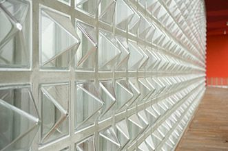 Textured Glass Block Pyramid Shape For A Dramatic Wall Style