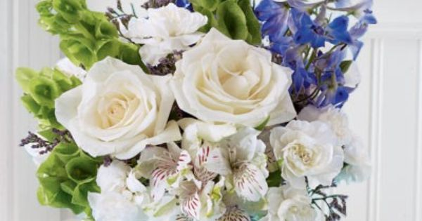 Centerpiece of blue flowers and white in a bubble