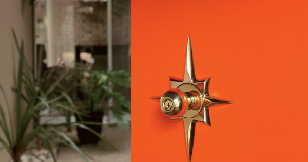 Orange door with mid-century modern-styled starburst Titan Exterior Door Set. This Jetsons-like