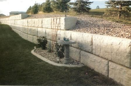 Large Concrete Retaining Wall Blocks The Block Creates Enough Slop To Allow The Block Landscaping Retaining Walls Retaining Wall Backyard Retaining Walls