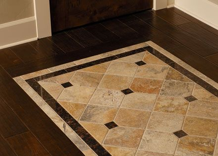 tile inlayed detail in wood floor match the shower to the travertine