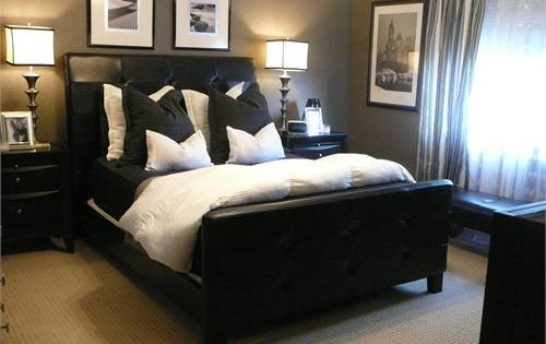 Loving the taupe/grey walls with the charcoal pillows and black and white