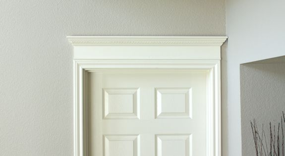 Crown molding above door diy tutorial decorchick blog for Over door decorative molding