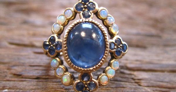 Opal & sapphire antique ring ....this is interestingly close to MY engagement