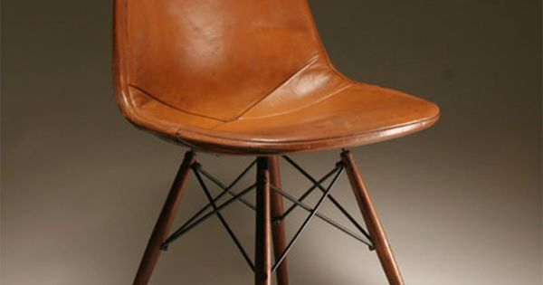 mid-century modern chair wrapped in leather