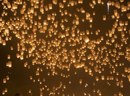 wanting to do a sky lantern instead of unity candle!Loy Kratong Floating Lantern Festival in Chiang Mai, Thailand (i'm scared of candles/fire, but this is pretty awesome)