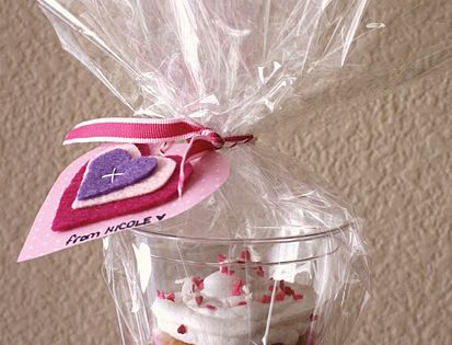 Awesome cupcake packages. Awesome way to package cupcakes. I think it's a 9oz plastic cup inside a treat bag with ribbon/tag. Love this!