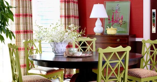 Red dining room with green chairs and leopard print (minus the leopard