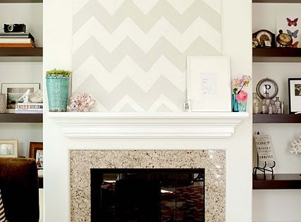 i love this! chevron art over the living room fireplace.