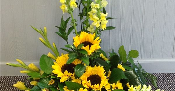 Sunflowers and snapdragons funeral arrangements