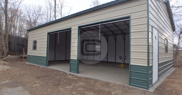 Side entry metal garage with 2 garage doors 1 man door for Garage side entry door