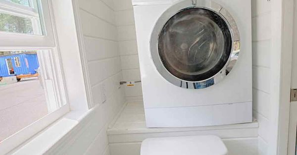 A ventless washer dryer combo in a tiny house bathroom at for Small bathroom designs with washer and dryer
