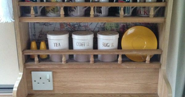 Line the back of the cupboards shelves with maps ideas for Caravan kitchen storage ideas