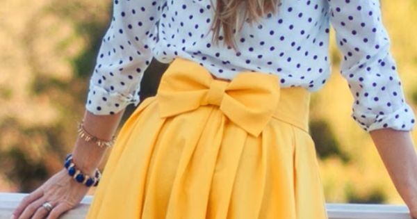 Loving this outfit! Yellow bow skirt. Black polka dot. Black heals. Spring. Casual. Cute.