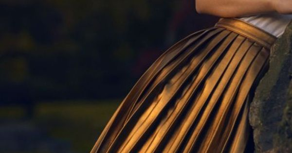 pleated metallic skirt for a sun kissed look