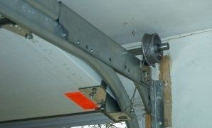 Fixing Garage Door Spring Tampa Fl With Images Garage Door Torsion Spring Garage Door Spring Repair Garage Door Springs