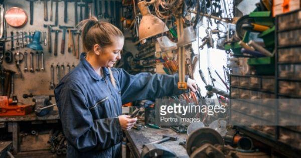Woman Working In A Work Shop Garage As A Motor Mechanic Surrounded By Motor Mechanics Woman Mechanic Girl Mechanics