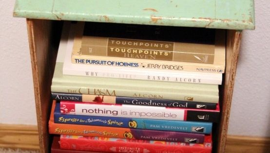 Old drawer as side table and book storage. I love this idea!
